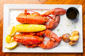 Two lobsters on a plate
