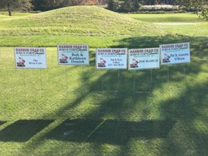 A photo of signs featuring sponsors of the golf outing.
