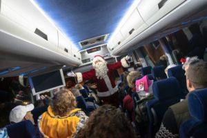 A photo of Santa on a bus.