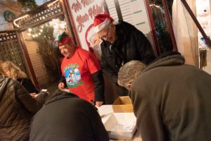 A photo of men collecting money for deserving families.