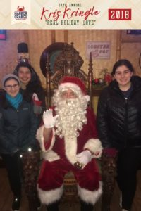 Three girls posing for a photo with Santa.