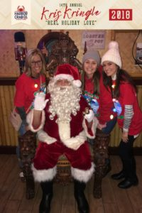 A group of people posing for a photo with Santa.
