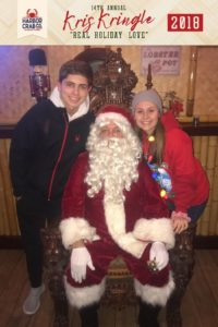 Two kids posing for a photo with Santa.