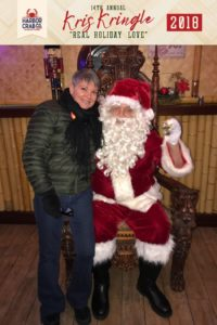 A person posing for a photo with Santa.