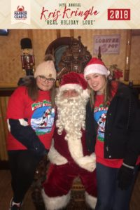 Two girls posing for a photo with Santa.