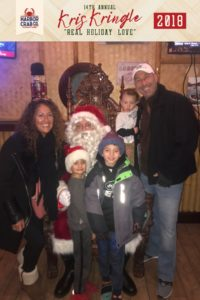 A family posing for a photo with Santa.