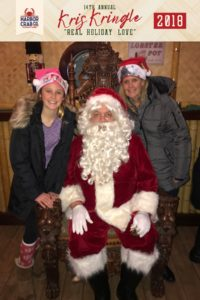 A girl and woman posing for a photo with Santa.
