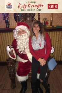 A woman posing for a photo with Santa.