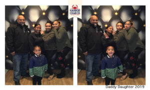 A photo of a family smiling for the Daddy Daughter 2019 event.