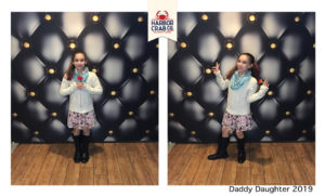 A photo of a little girl posing for the Daddy Daughter Event.