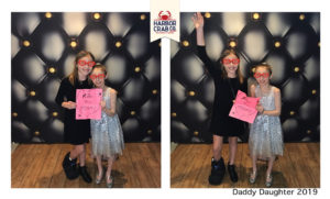 A photo of two girls smiling for the Daddy Daughter 2019 event.
