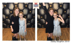 A photo of two girls smiling for the Daddy Daughter event.