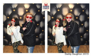 A photo of two kids smiling for the Daddy Daughter 2019 event.