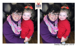 A photo of a woman and young girl smiling for the Daddy Daughter 2019 event.