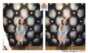 A photo of a young girl smiling for the Daddy Daughter 2019 event.