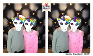A photo of two children posing for the camera with unicorn masks for the Daddy Daughter 2019 event.