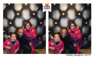 A photo of a father and two kids smiling for the Daddy Daughter 2019 event.