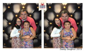 A photo of a father and two children smiling for the Daddy Daughter 2019 event.