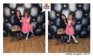 A photo of two girls smiling and posing for the Daddy Daughter event.