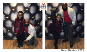 A photo of a father and daughter smiling for the Daddy Daughter 2019 event.
