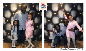 A photo of a family posing for the Daddy Daughter 2019 event.