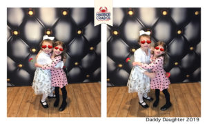 A photo of two little girls smiling for the Daddy Daughter 2019 event.